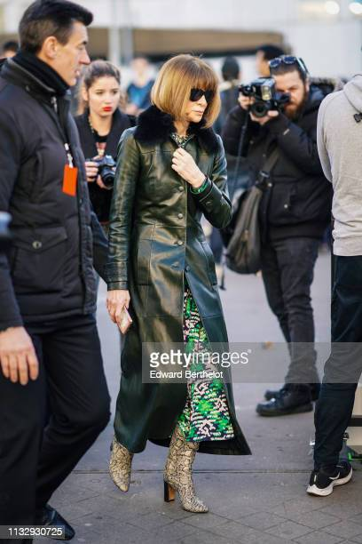 Anna Wintour wears a green leather coat snake print boots outside Chloe during Paris Fashion Week Womenswear Fall/Winter 2019/2020 on February 28...