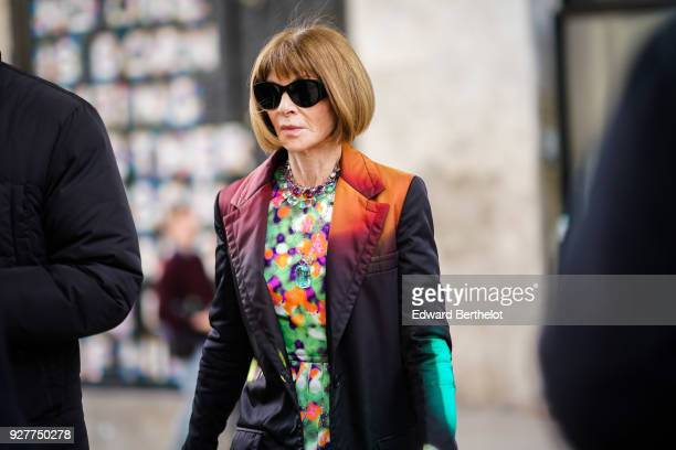 Anna Wintour wears sunglasses a colored blazer jacket a multicolor print dress during Paris Fashion Week Womenswear Fall/Winter 2018/2019 on March 5...