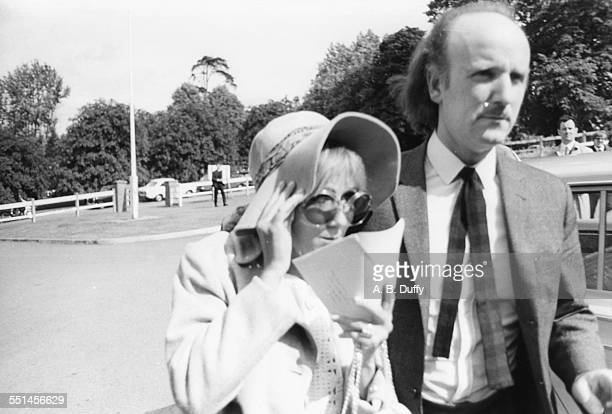 Anna Wohlin girlfriend of deceased 'Rolling Stones' Brian Jones hiding her face as she attends the inquest of his death with minder Frank Thorogood...