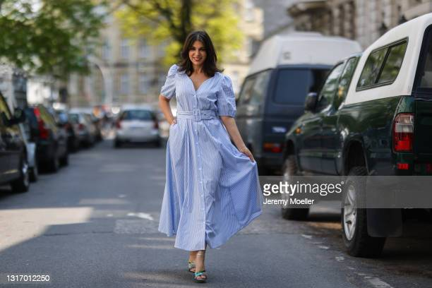 Anna Wolfers wearing blue midi dress and green heels on May 01, 2021 in Hamburg, Germany.