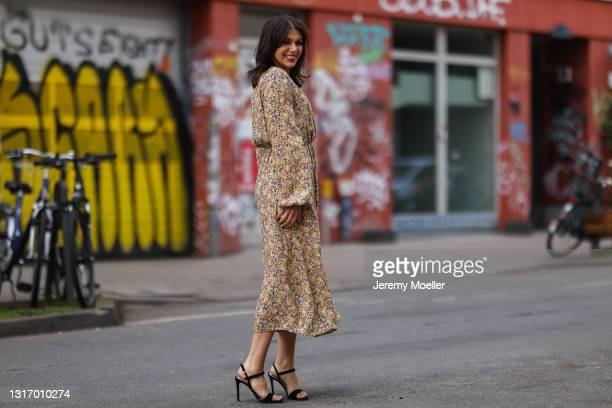 Anna Wolfers wearing yellow floral midi dress and black heels on May 01, 2021 in Hamburg, Germany.