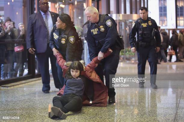 Anna Wood is dragged away to be arrested after sitting in the lobby of the Kluczynski Federal Building protesting President Donald Trump on January...