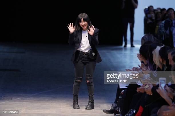 Anna Yang acknowledge the applause of the audience at the Annakiki show during Milan Fashion Week Spring/Summer 2018 on September 22 2017 in Milan...