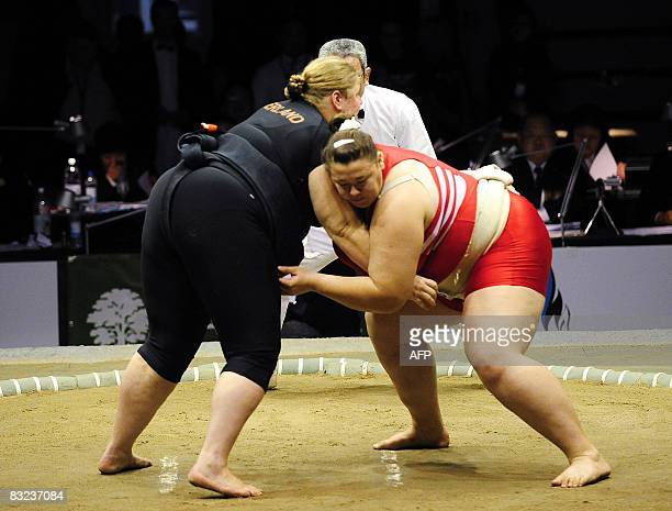 Anna Zhigalova of Russia vies with Francoise Harteveld of Netherlands in their women's open division match during the 16th Sumo World Championships...