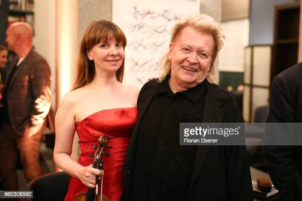 Anna Zlotovskaya and HA Schult attend the Housewarming Party at Andreas Quartier GmbH on October 11 2017 in Duesseldorf Germany