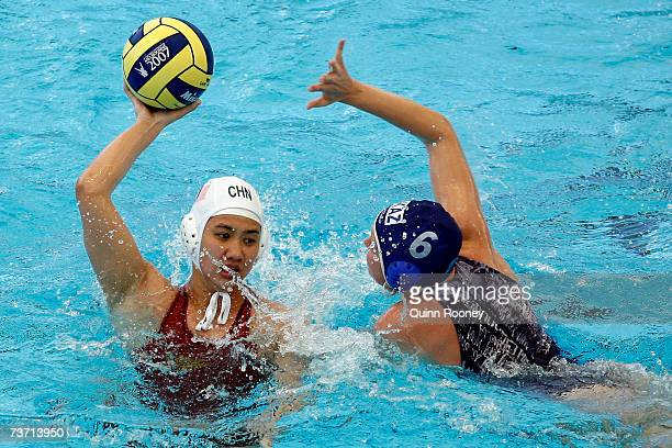 Anna Zubkova of Kazakhstan stops the pass from Ma Huanhuan of China in the Women's Final Round 13th14th place Water Polo match between China and...