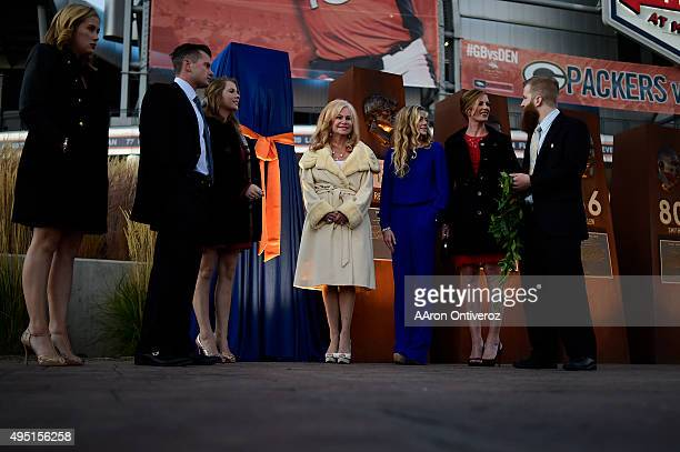 Annabel Bowlen is flanked by children from left to right John Christiana Annabel Beth Bowlen Wallace and Patrick III before the unveiling of her...