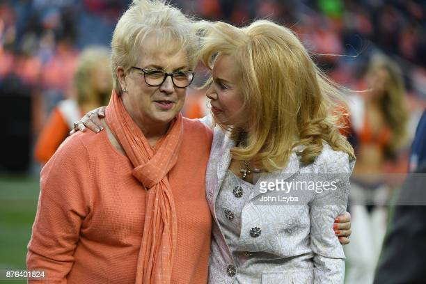 Annabel Bowlen right embraces Nan Miller widow of former Denver Broncos coach Red Miller for a Ring of Fame ceremony during the game against the...