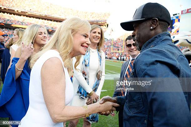 Annabel Bowlen shakes hands with Oscarnominated actor and Denver East High School graduate Don Cheadle before the first quarter The Denver Broncos...