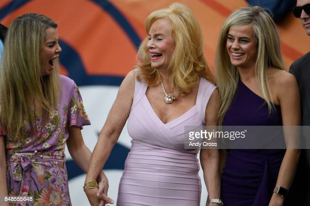 Annabel Bowlen stands with her daughters Annabel and Christiana on the field during the first quarter on Sunday September 17 2017 The Denver Broncos...