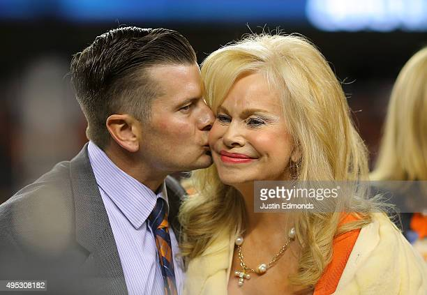 Annabel Bowlen wife of Denver Broncos owner Pat Bowlen is kissed by their son John as the two celebrate Pat Bowlen's induction as the 28th member of...