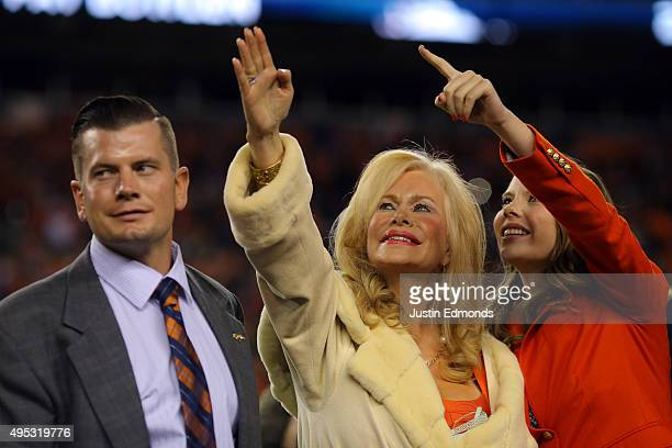 Annabel Bowlen wife of Denver Broncos owner Pat Bowlen waves alongside their son John as they celebrate Pat Bowlen's induction as the 28th member of...