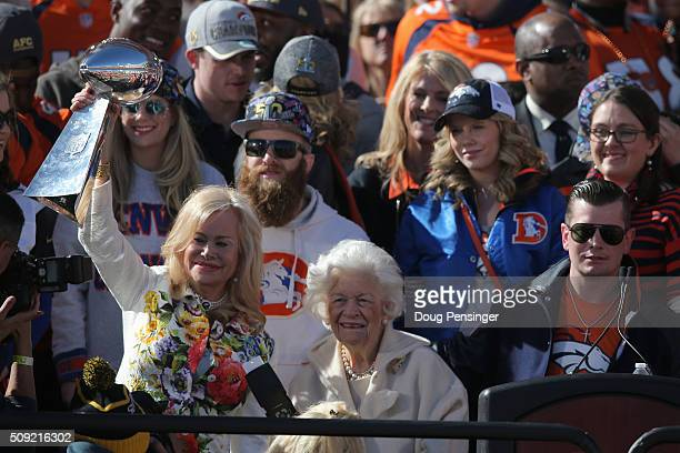 Annabel Bowlen wife of Pat Bowlen owner and CEO of the Denver Broncos hoists the Lombardi Trophy along with her mother Joan Spencer and son John...