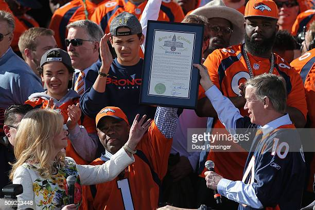 Annabel Bowlen wife of Pat Bowlen owner and CEO of the Denver Broncos is presented a proclamation by Denver Mayor Michael Hancock and Colorado...