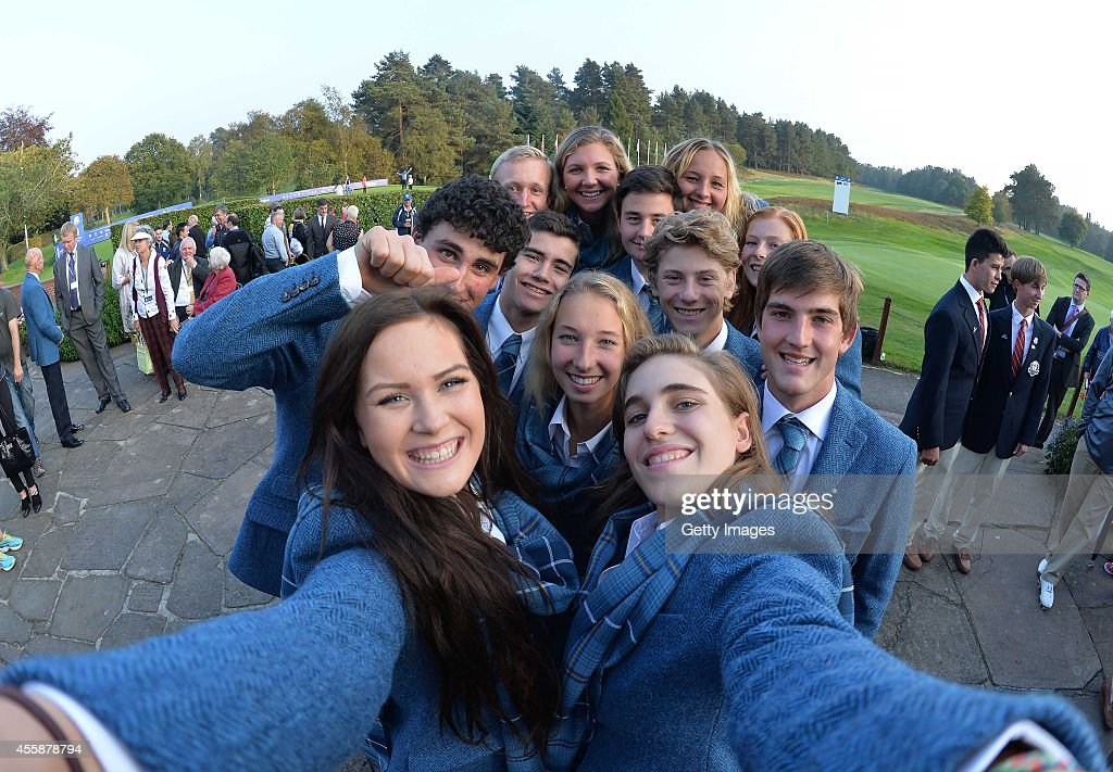 Annabel Dimmock (L), and Virginia Elena Carta of Team Europe ask to borrow a camera for a Selfie with their team during the Opening Ceremony of the 2014 Junior Ryder Cup at Blairgowrie Golf Club on September 21, 2014 in Perth, Scotland.