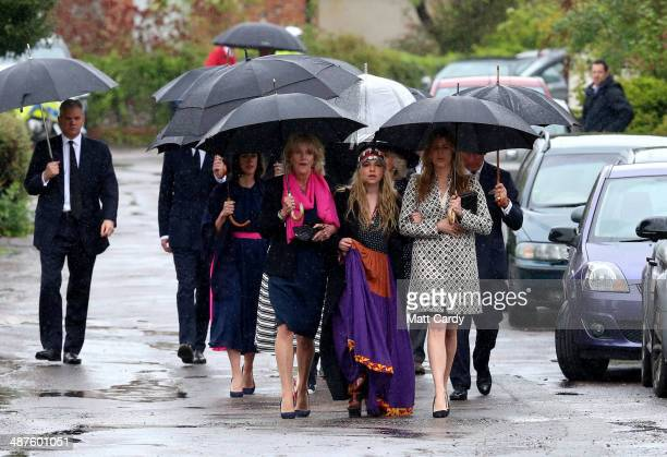 Annabel Elliot Mark Shand's daughter Ayesha Shand and Katie Elliot arrive at Holy Trinity Church for the funeral of Mark Shand in Stourpaine on May 1...