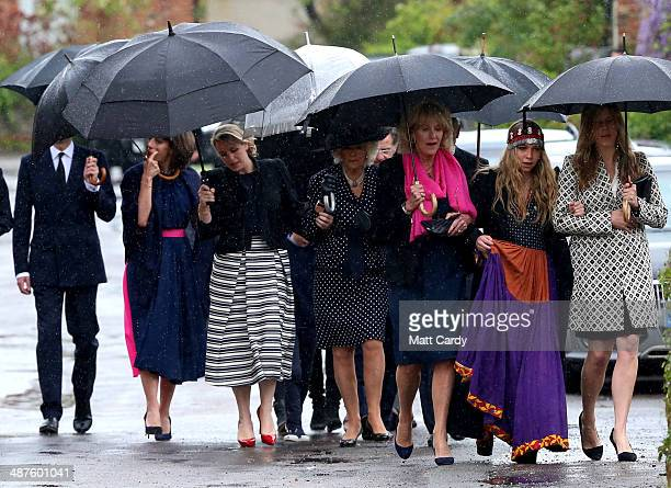 Annabel Elliot Mark Shand's daughter Ayesha Shand and Katie Elliot lead others including Camilla Duchess of Cornwall as they arrive at Holy Trinity...