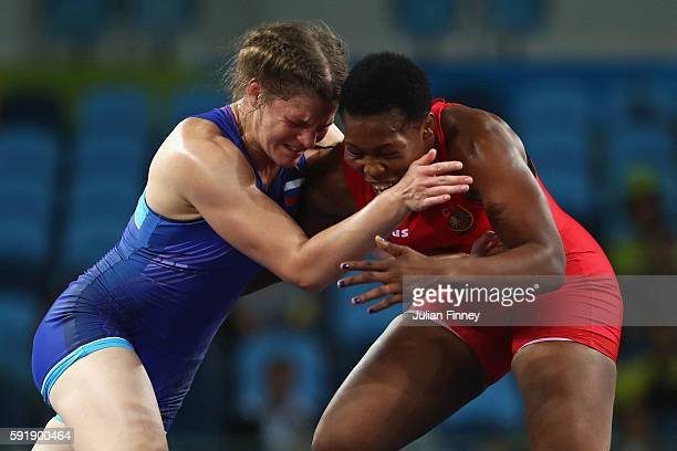 Annabel Laure Ali of Cameroon competes against Ekaterina Bukina of Russia during the Women's Freestyle 75 kg Bronze medal match on Day 13 of the Rio...