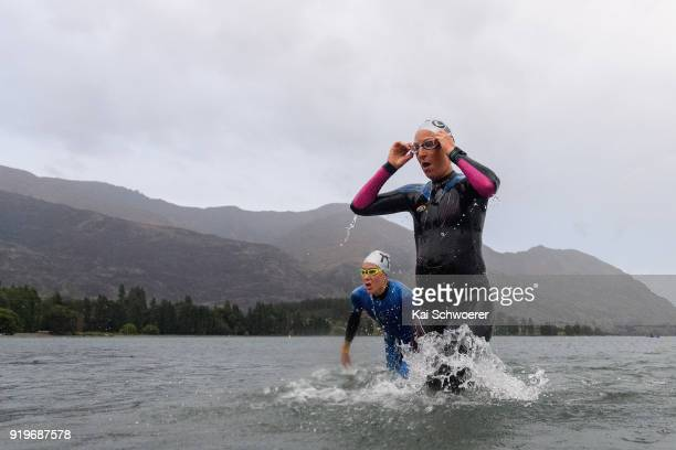 Annabel Luxford of Australia and Rebecca Clarke of New Zealand exit the water during 2018 Challenge Wanaka on February 17 2018 in Wanaka New Zealand