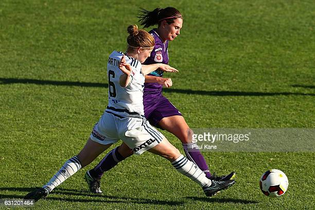 Annabel Martin of the Victory and Rosie Sutton of the Glory contest for the ball during the round 11 WLeague match between the Perth Glory and...