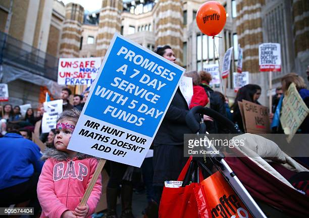 Annabel Pickstone holds a placard as Junior Doctors protest outside the Department of Health at the Government's intention to impose new contracts on...