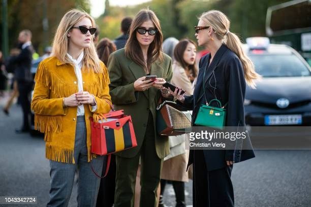 Annabel Rosendahl and Darja Barannik and Tine Andrea wearing green Hermes bag is seen outside Hermes during Paris Fashion Week Womenswear...
