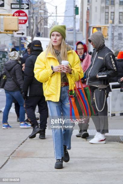 Annabel Rosendahl is seen at Spring Studios outside the Phillip Lim show wearing bright leather yellow jacket high waist denim jeans green knit...