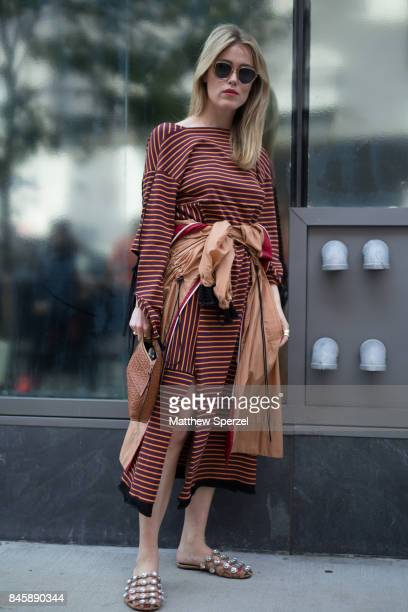 Annabel Rosendahl is seen attending 31 Phillip Lim during New York Fashion Week wearing a copper striped dress on September 11 2017 in New York City