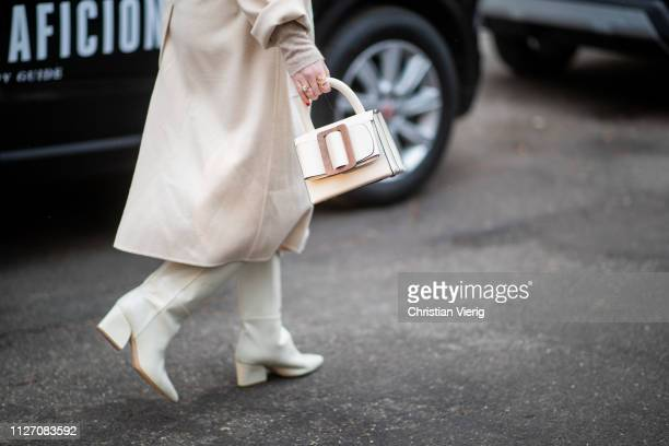 Annabel Rosendahl is seen wearing belted coat bag outside Baum und Pferdgarten during the Copenhagen Fashion Week Autumn/Winter 2019 Day 3 on January...