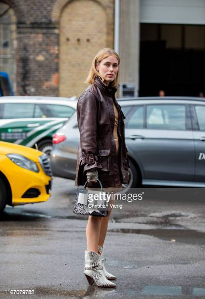 Annabel Rosendahl is seen wearing brown leather jacket two tone bag cowboy boots with snake print outside Baum und Pferdgarten during Copenhagen...