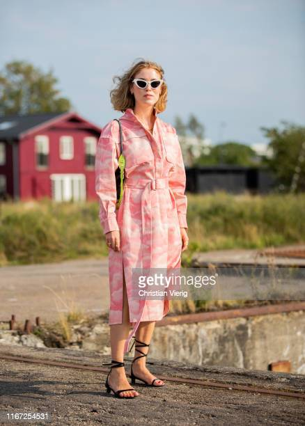 Annabel Rosendahl is seen wearing pink belted coat outside Cecilie Bahnsen during Copenhagen Fashion Week Spring/Summer 2020 on August 07, 2019 in...