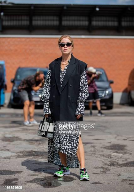 Annabel Rosendahl is seen wearing sleeveless jacket, dress, sneker, two tone black white Boyy bag outside By Malene Birger during Copenhagen Fashion...