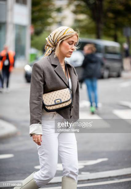 Annabel Rosendahl is seen wearing white pants brown blazer head scarf outside Dries van Noten during Paris Fashion Week Womenswear Spring Summer 2020...