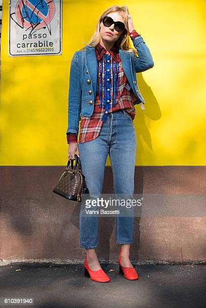 Annabel Rosendahl poses wearing a Gucci denim jacket, Coach shirt, Louis Vuitton bag and Celine shoes after the Marni show during Milan Fashion Week...