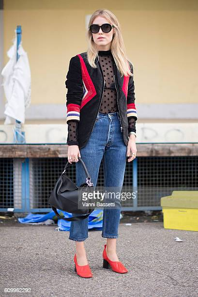 Annabel Rosendahl poses wearing an Isabel Marant jacket Celine pants and shoes and Loewe bag before the Diesel Black Gold show during Milan Fashion...