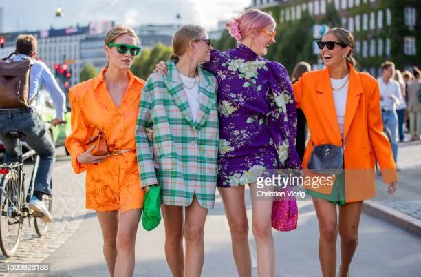 Annabel Rosendahl, Tine Andrea wearing green checkered oversized blazer Darja Barannik wearing orange dress, blazer, purple dress seen outside Baum...