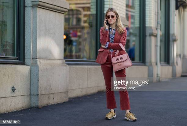 Annabel Rosendahl weairng a velvet suit JW Anderson bag outside Fam Irvoll on August 22 2017 in Oslo Norway