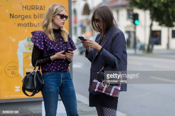 1fa98025741251 Annabel Rosendahl wearing a black Loewe bag purple blouse denim jeans and  Darja Barannik wearing grey