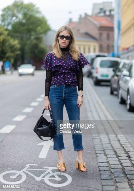 Annabel Rosendahl wearing a black Loewe bag purple blouse denim jeans outside Vanessa Rudjord on August 24 2017 in Oslo Norway