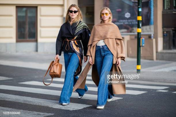 Annabel Rosendahl wearing a brown bag Loewe scarf denim jeans and Tine Andrea wearing brown coat denim jeans seen during Stockholm Runway SS19 on...