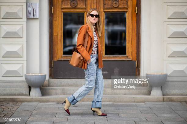 Annabel Rosendahl wearing a brown blazer denim jeans is seen during Stockholm Runway SS19 on August 28 2018 in Stockholm Sweden