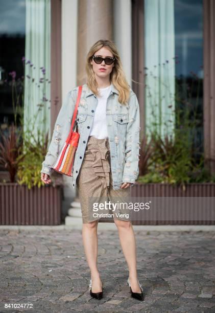 Annabel Rosendahl wearing a denim jacket brown skirt Dior slingbacks outside By Malina on August 30 2017 in Stockholm Sweden