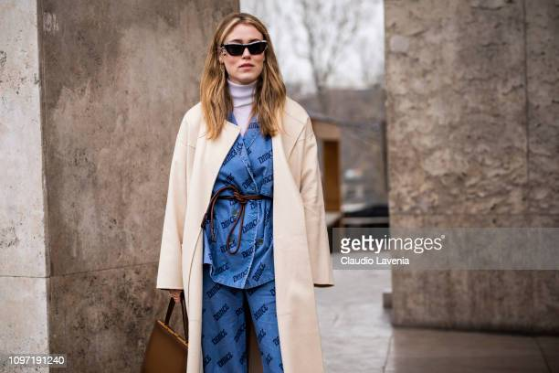 Annabel Rosendahl, wearing a denim printed suit, long beige coat and brown bag, is seen in the streets of Paris before the Acne Femme show on January...