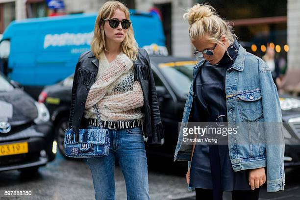 Annabel Rosendahl wearing a fishnet sweater black leather jacket with fringes blue denim jeans and Louis Vuitton bag outside WHYRED during the first...