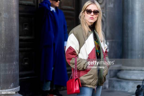 Annabel Rosendahl wearing a olive white red striped jacket red Chanel bag denim jeans black Gucci tshirt on February 7 2017 in Oslo Norway