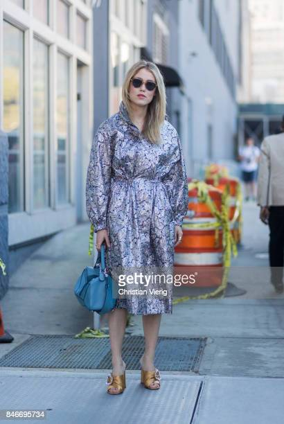 Annabel Rosendahl wearing a silver coat seen in the streets of Manhattan outside Michael Kors during New York Fashion Week on September 13 2017 in...