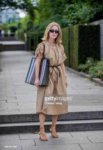 Annabel Rosendahl wearing beige dress is seen outside Mykke Hofmann during Copenhagen Fashion Week Spring/Summer 2020 on August 06 2019 in Copenhagen...