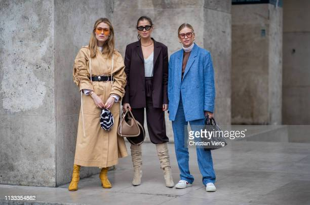 Annabel Rosendahl wearing belted trench coat zebra print bag Darja Barannik wearing bordeaux blazer pants beige boots Boyy bag and Tine Andrea...