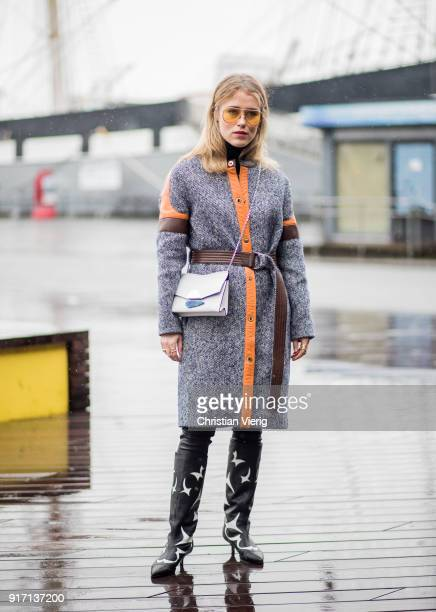 Annabel Rosendahl wearing black boots grey orange wool coat seen outside Tibi on February 11 2018 in New York City