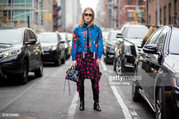 Annabel Rosendahl wearing blue jacket with print red black skirt black boots bag with print seen outside SelfPortrait on February 10 2018 in New York...